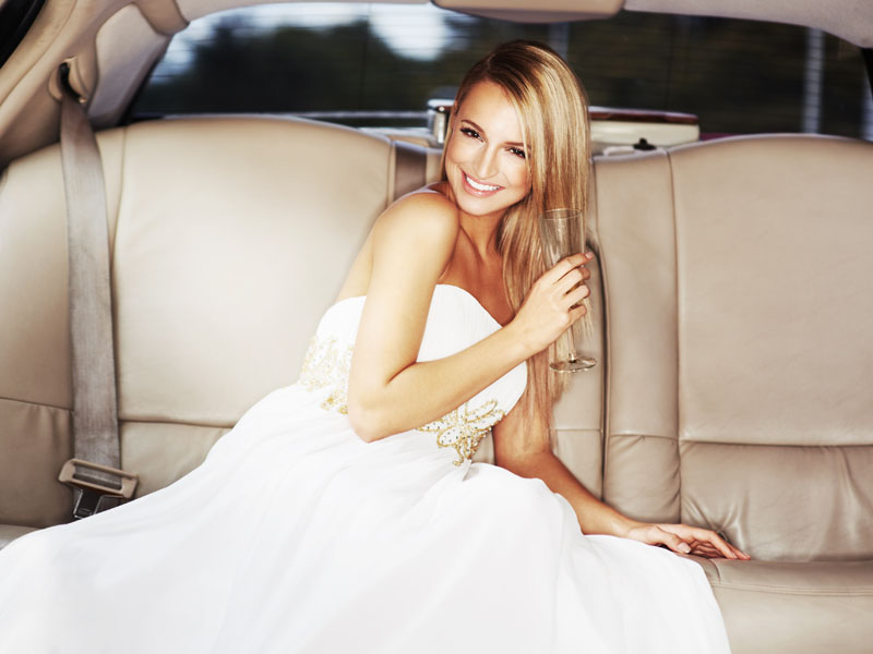 sitting in a white wedding limo